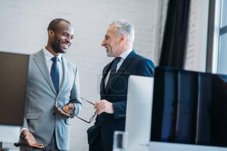 portrait of smiling multiracial businessmen in office