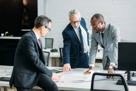Photo for Multiethnic businessmen discussing new business strategy on meeting in office - Royalty Free Image