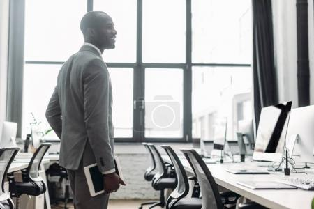 african american businessman with tablet in hand in office