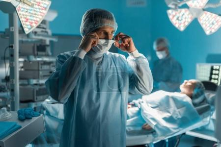 surgeon wearing medical mask in operating room
