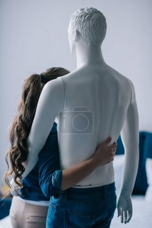 back view of woman hugging layman doll, perfect relationship dream concept