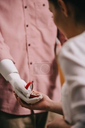 woman and mannikin with jewelry box in hand, perfect relationship and marriage dream concept