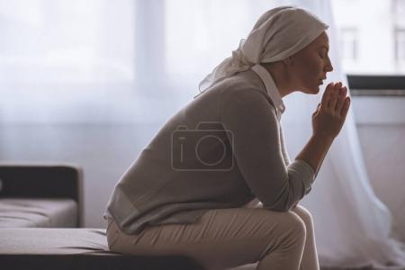 Photo for Side view of sick mature woman in kerchief praying, cancer concept - Royalty Free Image
