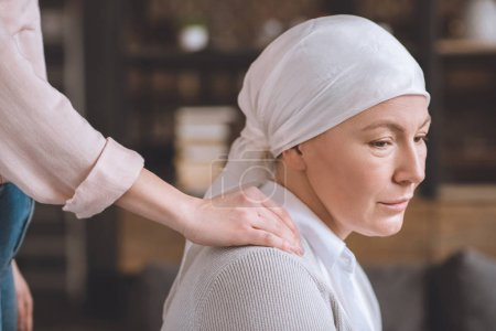 cropped shot of woman supporting sick upset mature mother in kerchief