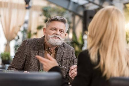 Photo for Selective focus of senior man and woman in cafe - Royalty Free Image