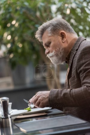side view of man having dinner in restaurant