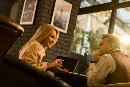 business people having discussion during meeting in cafe