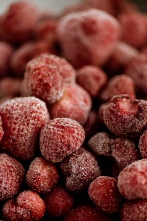 close-up shot of red frozen raspberries