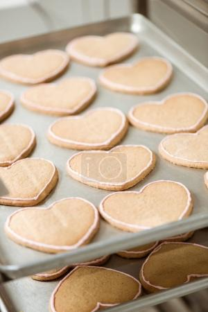 close-up shot of delicious cookies in shape of heart on tray