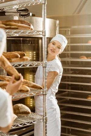 Photo for Female bakers working together at baking manufacture - Royalty Free Image