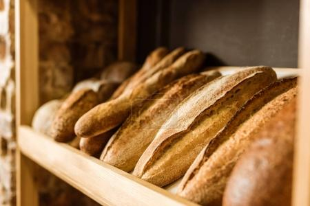 Photo for Close-up shot of rural bread on shelf at pastry store - Royalty Free Image