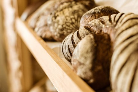 close-up shot of various rural bread on shelf at pastry store