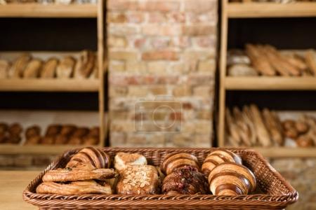 Photo for Various croissants in basket on pastry store display - Royalty Free Image