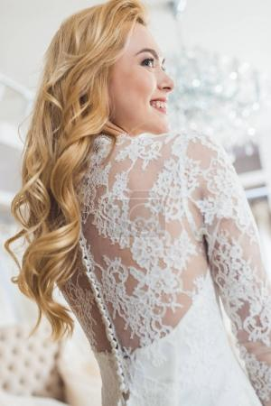 Bride in lace dress in wedding fashion shop