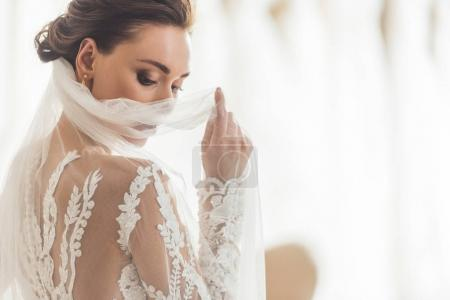 Photo for Stylish bride in lace dress in wedding salon - Royalty Free Image