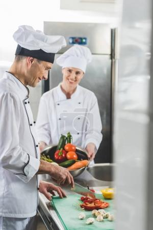Photo for Chef cutting vegetables at restaurant kitchen - Royalty Free Image
