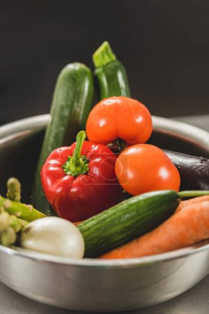 bowl of ripe organic vegetables on table at restaurant kitchen