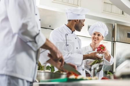 multicultural chefs at work in restaurant kitchen