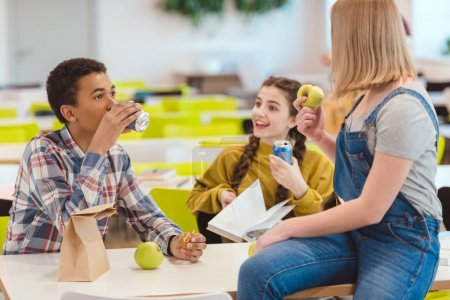 high school students taking lunch together at school cafeteria