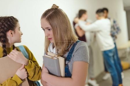 shocked schoolgirls passing away schoolboy being bullied in school corridor