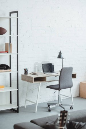 interior of modern living room with laptop on working table
