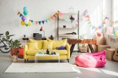 Interior of cozy room decorated with balloons and garland for party