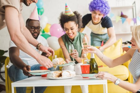 Young attractive women and handsome men celebrating at birthday party