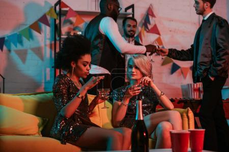 Multiracial friends having party with champagne drinks
