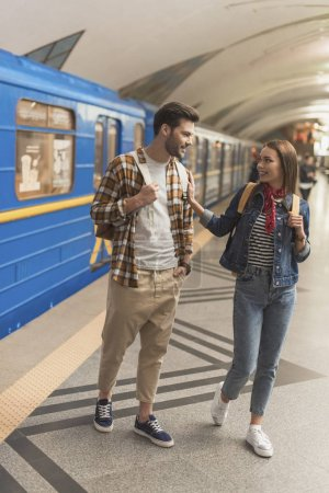 young stylish couple of tourists at metro station