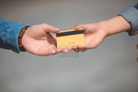 cropped shot of male and female hands with credit card