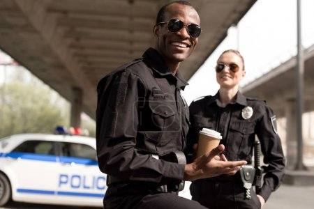 happy young police officers having coffee break