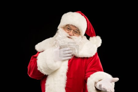 Photo for Portrait of Santa Claus gesturing and looking at camera - Royalty Free Image