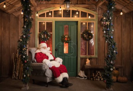 Photo for Santa Claus sleeping in grey armchair at Christmas time - Royalty Free Image