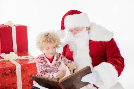 Santa Claus and kid reading book together