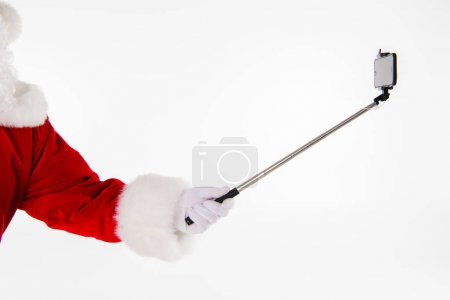 Santa Claus hand showing selfiestick