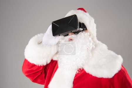 Photo for Portrait of Santa Claus wearing virtual reality headset - Royalty Free Image