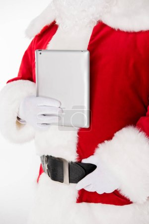 Santa Claus posing with digital tablet