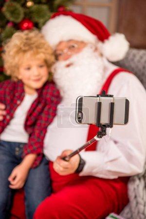Santa Claus with kid on knee