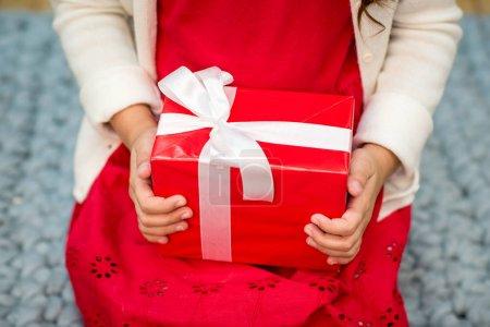 Kid holding gift box