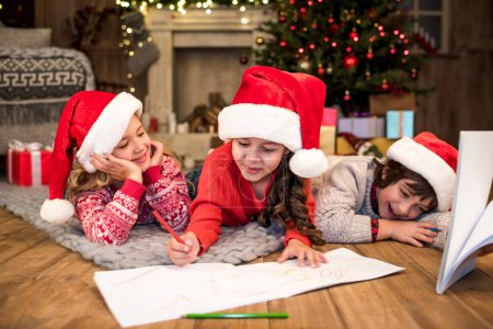 Photo for Happy kids having fun and drawing picture together - Royalty Free Image