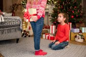 Kid ready to give gift box to friend