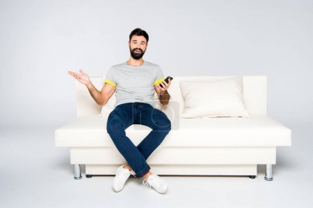 Bearded man using smartphone