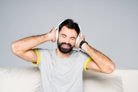 Bearded man in white headphones