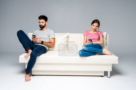 Couple using smartphones