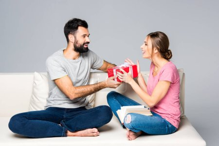 Man giving gift box to woman