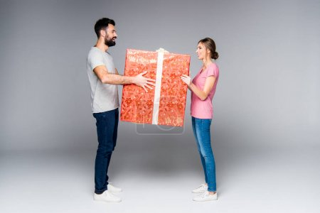 Couple with red gift box