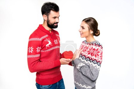 Couple standing with red heart
