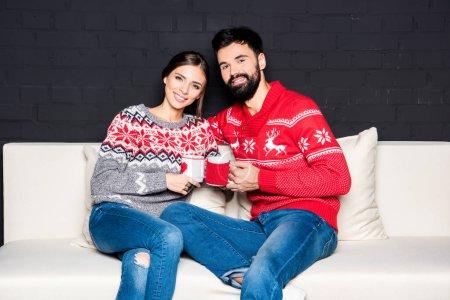 Happy couple drinking hot tea