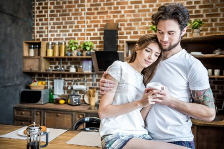Couple holding coffee cup