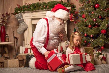 Santa Claus showing Christmas presents